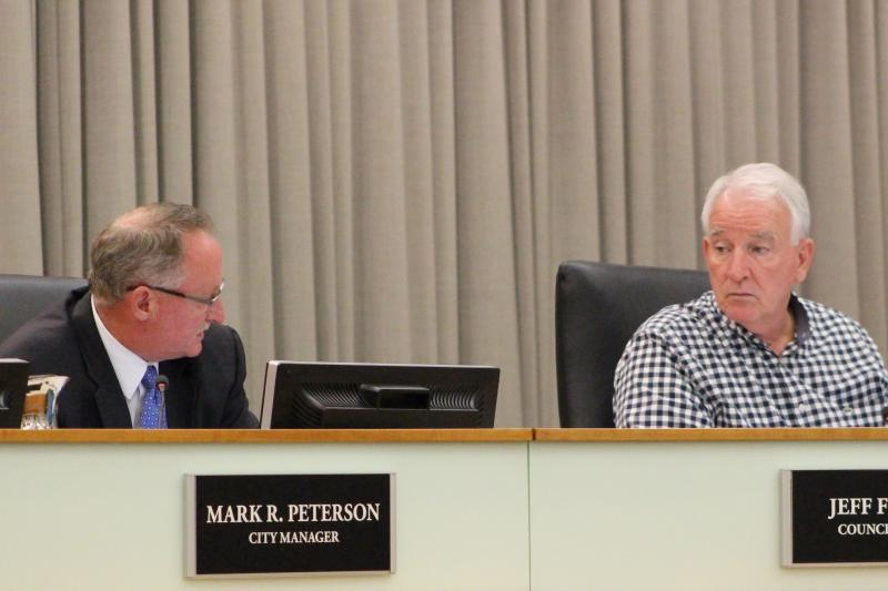 Normal City Manager Mark Peterson and Council Member Jeff Fritzen discuss the Zagster proposal.