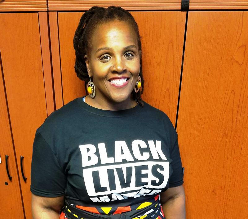Female professor wearing Black Lives Matter t-shirt