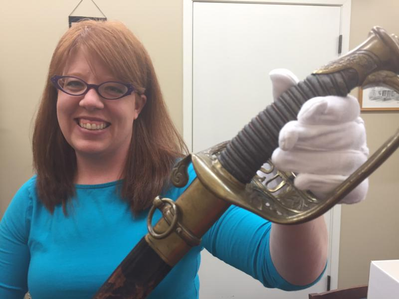 April Anderson with Charles Hovey's saber.