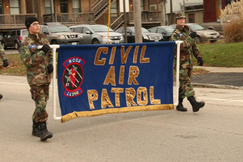 Men of the Civil Air Patrol begin the parade route wishing standbyers a Merry Christmas.