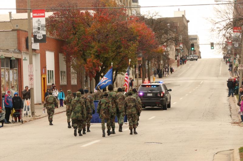 Men of the Civil Air Patrol proudly make thier way downtown.