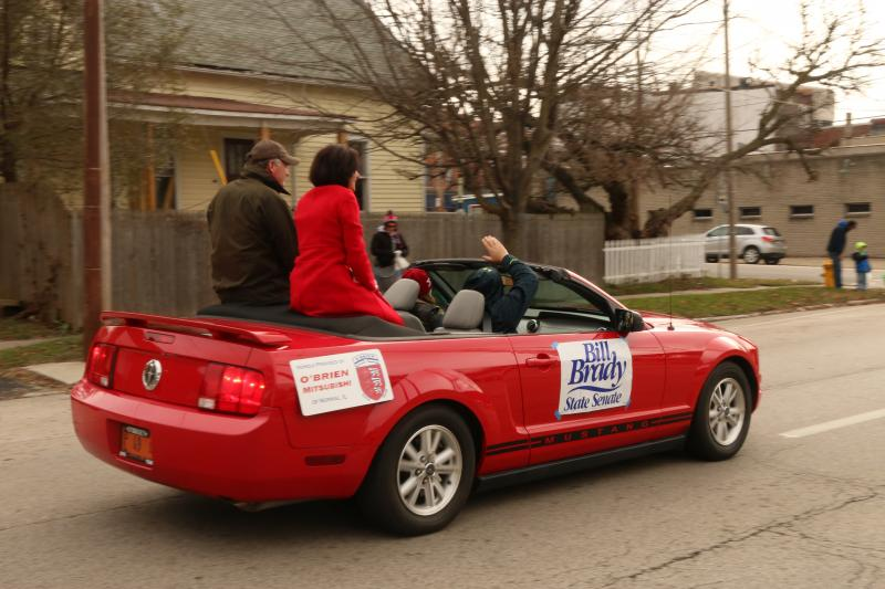 Bill Brady rides in style during the Jaycee Christmas Parade.