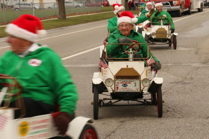 The men of Mohammed Shriners trolling down the parade route in little cars.
