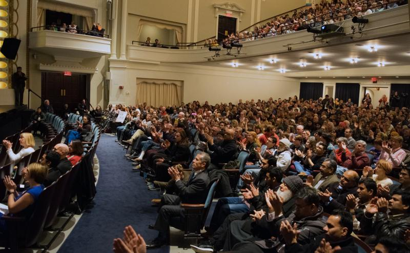The audience applauds a speaker during the rally.