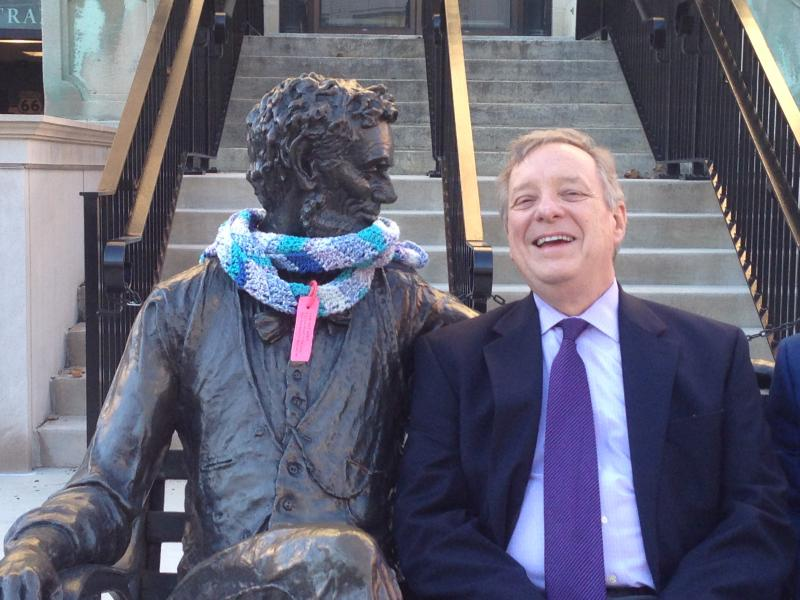 U.S. Senator Dick Durbin shares a joke with Abe Lincoln outside the McLean County Museum of History