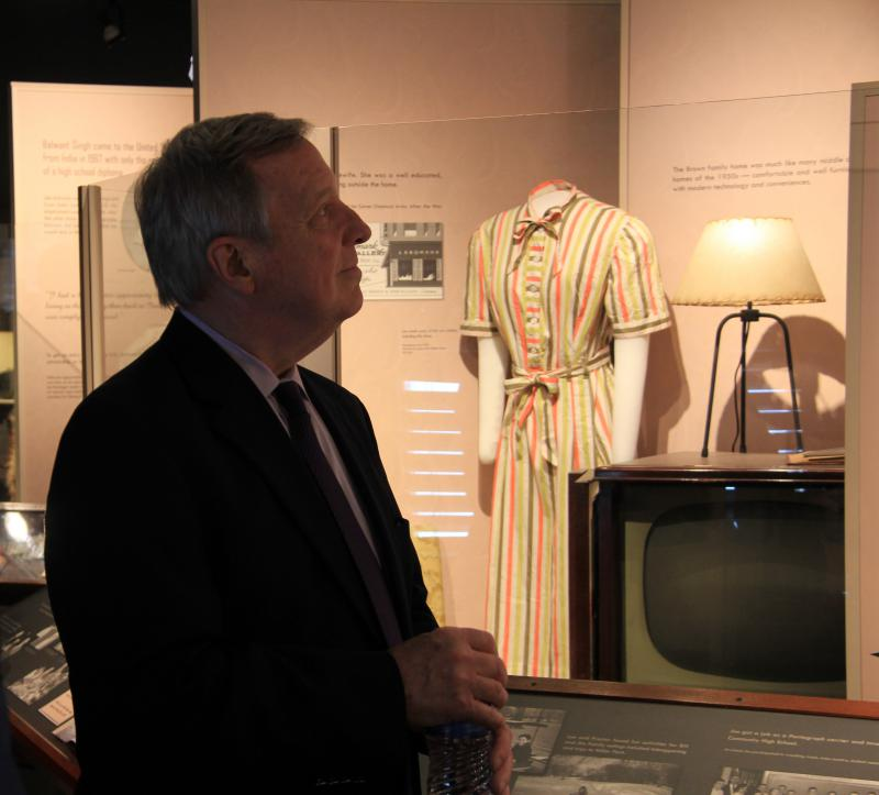 U.S. Senator Dick Durbin looks at the immigration history of McLean County during a visit to the Museum of History in Bloomington.