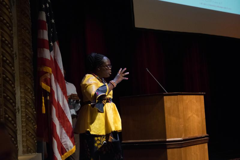 ISU Teaching Assistant Sephrine Achesah telling the audience about experience as an immigrant from Kenya.