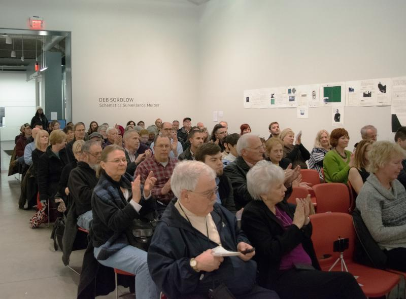 A crowd of about 90 people packed the University Galleries at Uptown Station