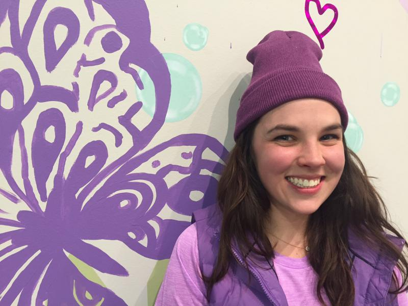 Erin and one of the massive butterflies she added to the walls of the installation.