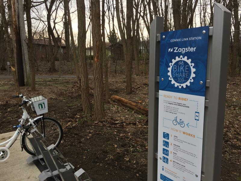 The only bike share station on the Constitution Trail is located across from the Connie Link Amphitheater.