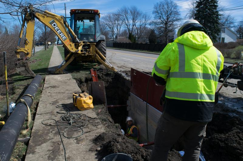 Town of Normal workers above and in the pit finishing water main repairs Friday afternoon.