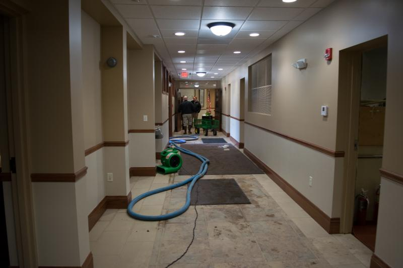 Clean up at Epiphany school after a broken water main flooded the building.