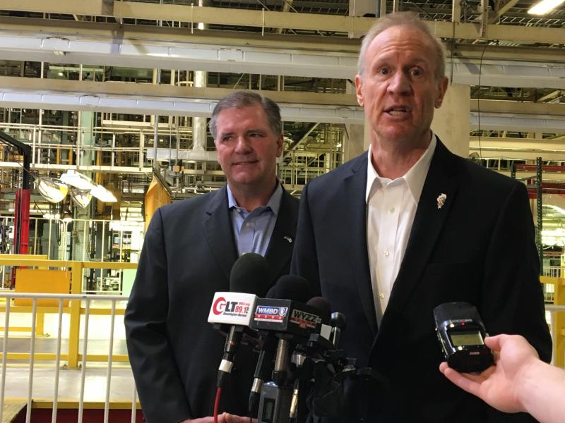 Governor Bruce Rauner talking to media members about his goals for more businesses throughout the state.