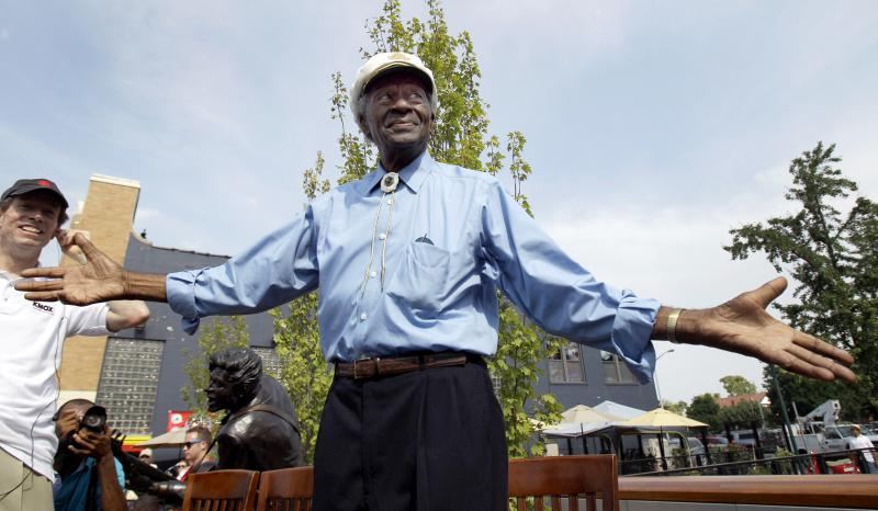 Legendary musician Chuck Berry acknowledges cheering fans as he is introduced during the dedication of a statue in his honor Friday, July 29, 2011, in University City, Mo.