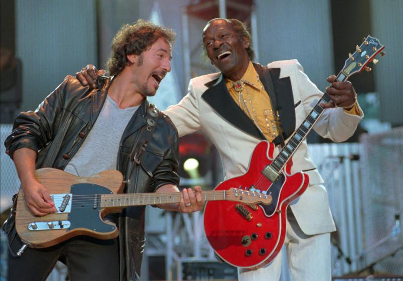 "Bruce Springsteen, left , and Chuck Berry laugh during the performance of the Berry hit ""Johnny B. Goode"" at the Concert for the Rock and Roll Hall of Fame in Cleveland on Saturday, Sept. 2, 1995. Berry was the opening act of the concert."