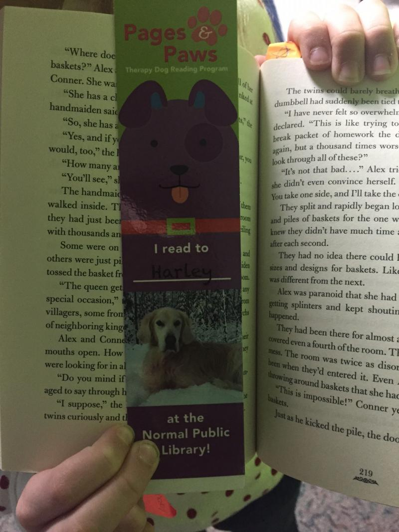 Kids who read to the dogs get to take home a special bookmark.