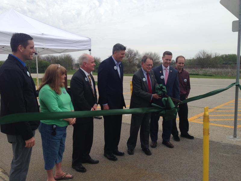 Assembled elected leaders cut the ribbon on the new eight mile stretch of bike trail from Normal to Towanda.