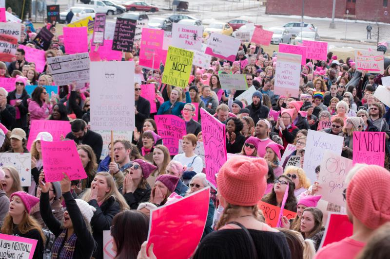 Bloomington-Normal residents attend a rally in February supporting Planned Parenthood.