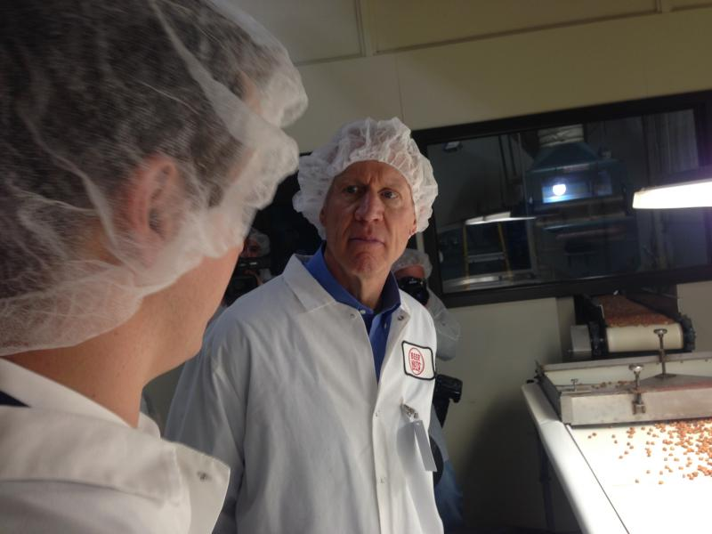 Governor Bruce Rauner looks at a nut inspection line at Beer Nuts in Bloomington