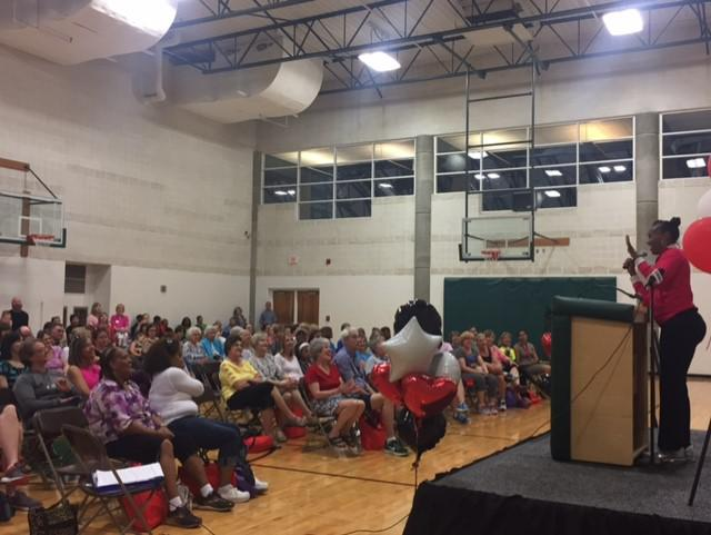 Gymnasium with chairs full of attendees at Women's Health Night event at the Shirk Center