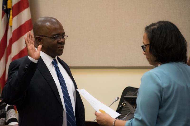 Alderman Mboka Mwilambwe takes the oath of office for a second time in Bloomington.