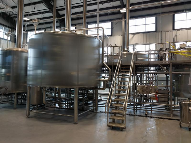 Water, barley, and yeast cook to a wort in the brewhouse.