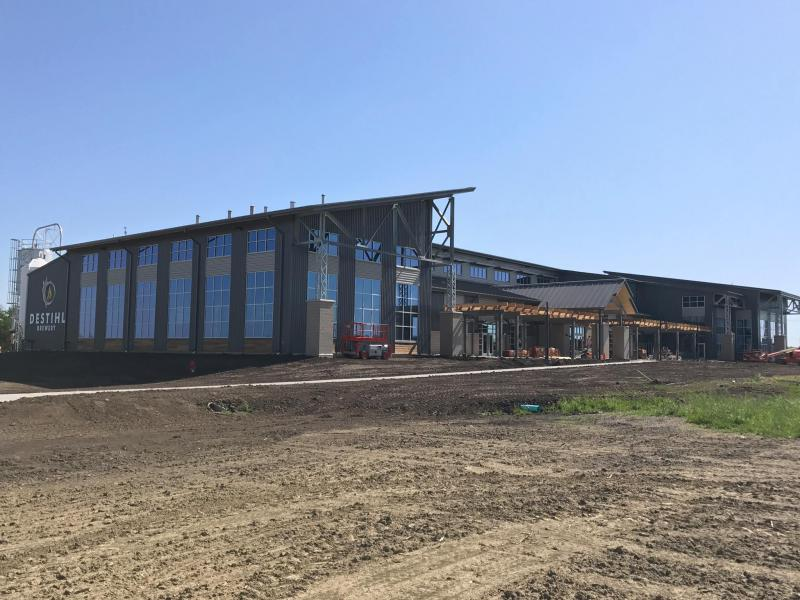 Destihl Brewery is holding the grand opening for its new facility May 27.