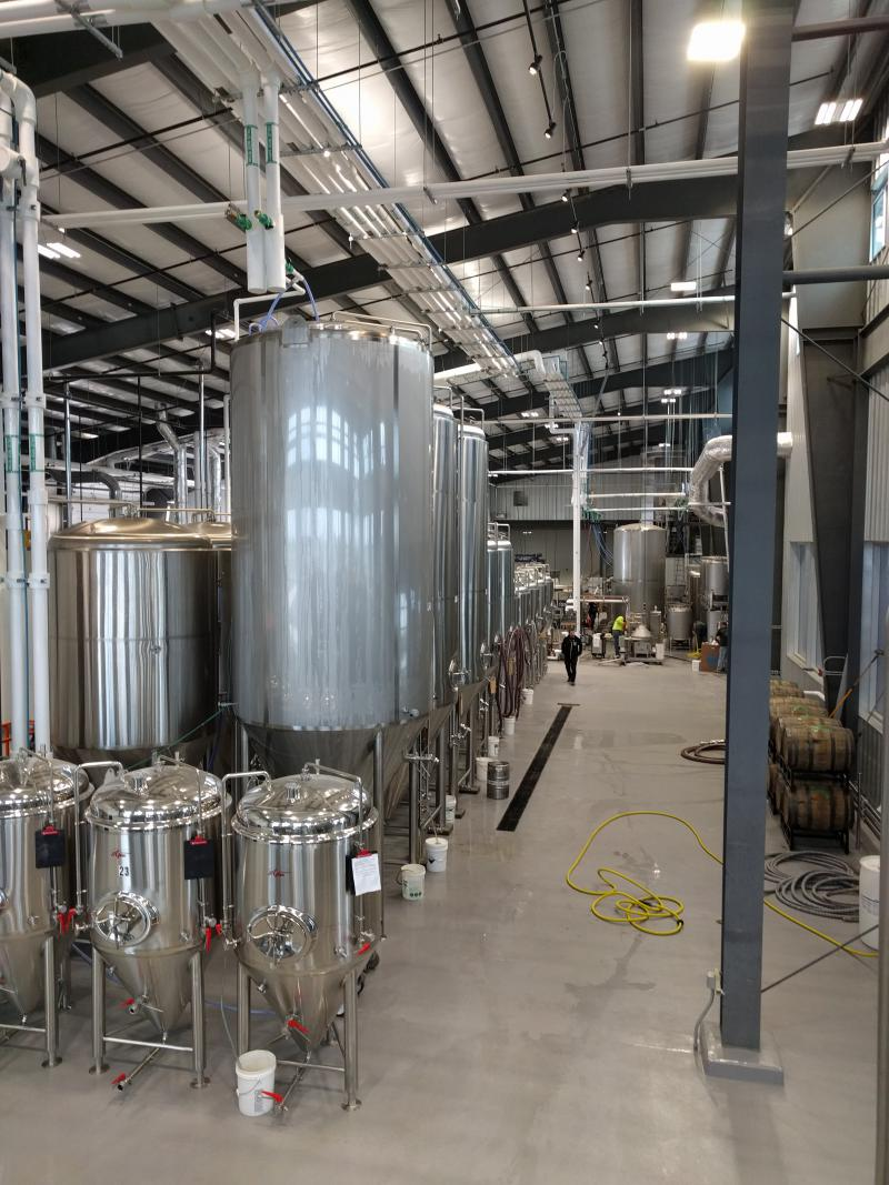 The fermenters hold the wort while the yeast chows down  on the sugar in the grain to produce alcohol.