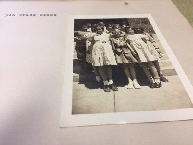Black and white copy of small group of 5th grade students in 1936.