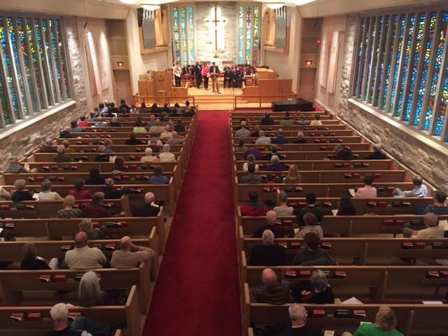 Second-floor choir loft view of the gathering at First United Methodist Church in Normal