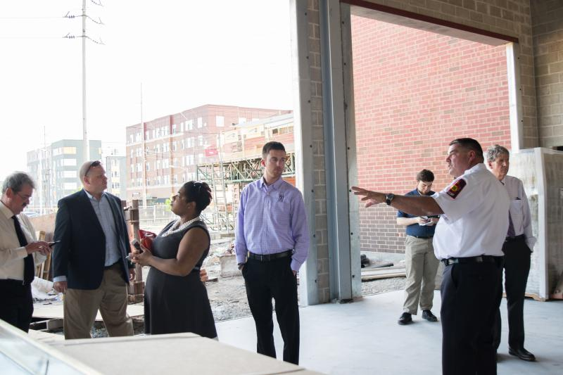 Town Communiction Director Dan Irvin, Council members R.C. McBride, Chemberly Cummings, Scott Preston, andMayor Chris Koos listen to details of the garage portion of the new fire station.