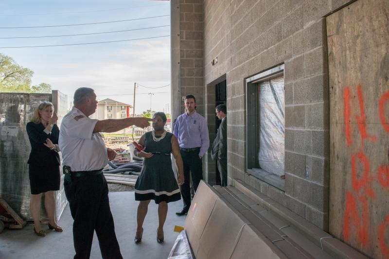 Town of Normal Deputy City Manager Pam Reece, council members Chemberly Cummings, and Scott Preston view the janitors closet.