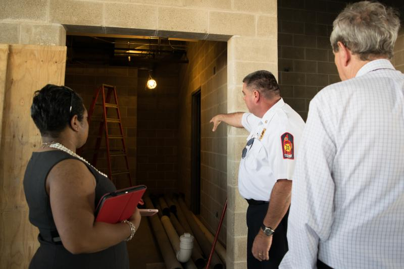 Council member Cummings and Mayor Koos view the medicine room that will hold emergency and first aid equipment.