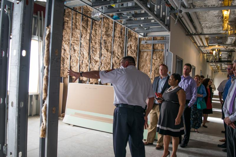 The Normal City Counil view the locker room portion of the new fire station.