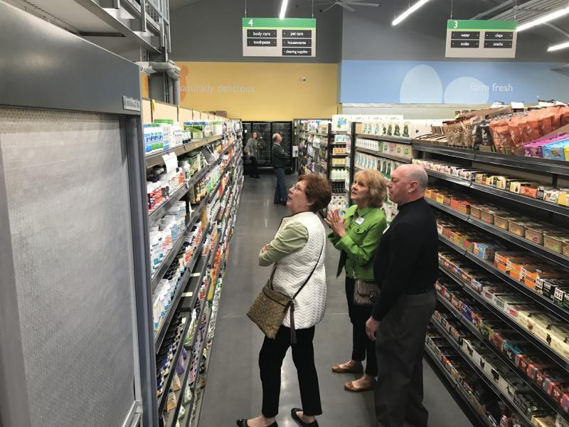 3 shoppers look at products