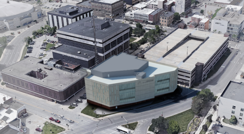 An aerial view shows a rendering of the jail expansion (bottom right) next to the existing jail (bottom left) and the McLean County Law and Justice Center (top)