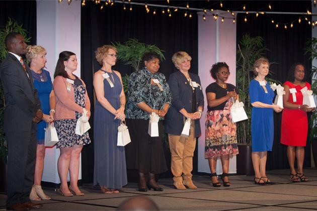 Eight women who won Women of Distinction Awards for 2017 on stage at Marriott Hotel.