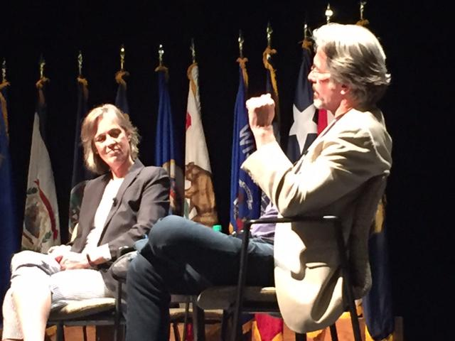 Theater Professor Lori Adams seated on stage with Actor and Alum Gary Cole