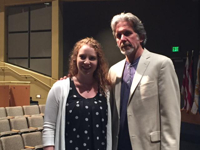ISU student on stage posing for photo with Actor Gary Cole