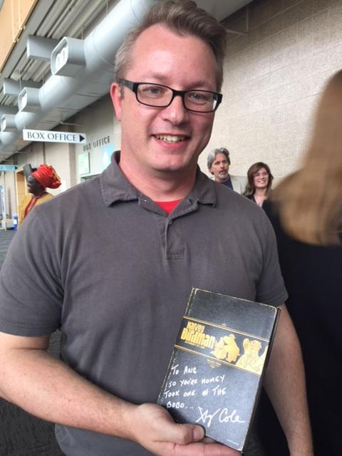 Guy holding an autographed DVD