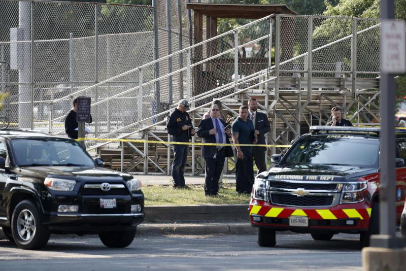 Law enforcement officers investigate the scene of a shooting near a baseball field in Alexandria, Va., Wednesday, June 14, 2017, where House Majority Whip Steve Scalise of La. was shot at a Congressional baseball practice.