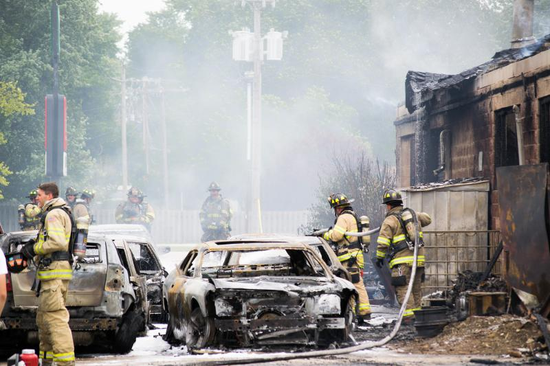 Cars behind the building after the fire.