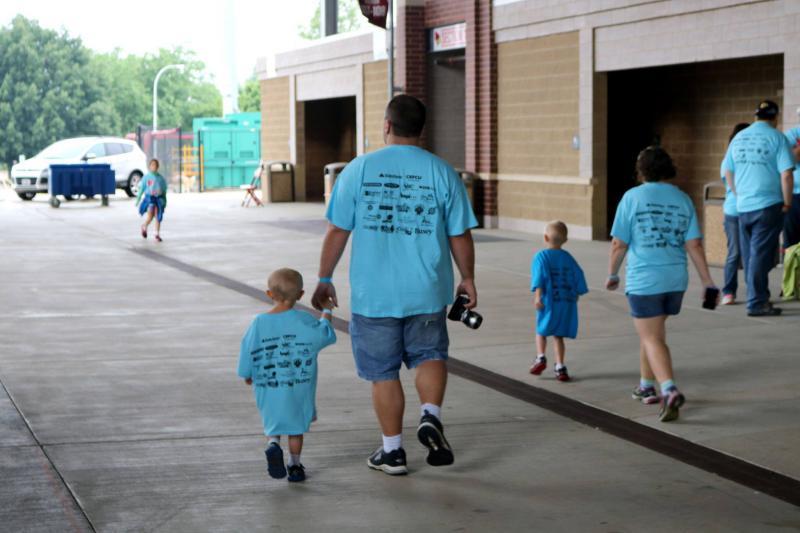 Family walks inside Hancock Stadium
