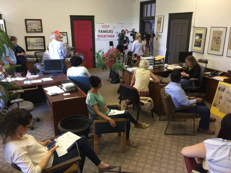 Social justice groups are seen Tuesday, July 25, 2017, during their calls to Gov. Bruce Rauner's office about the Illinois Trust Act.
