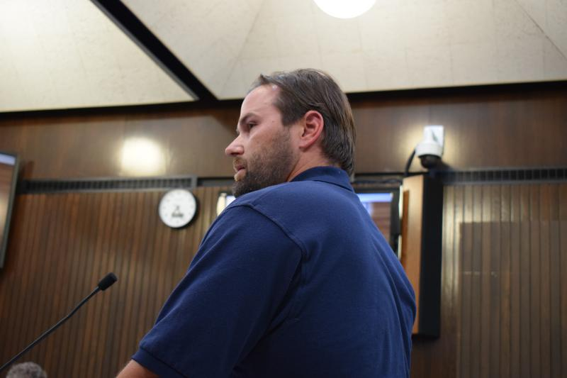 Bloomington police officer Stephen Brown, representing the police union (PBPA Unit 21), talks to aldermen Monday night.