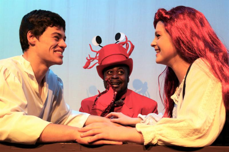 "From left, Joe Collins (Eric), Matthew Henry (Sebastian), and Dayle Hennenfent (Ariel) in ""The Little Mermaid."""