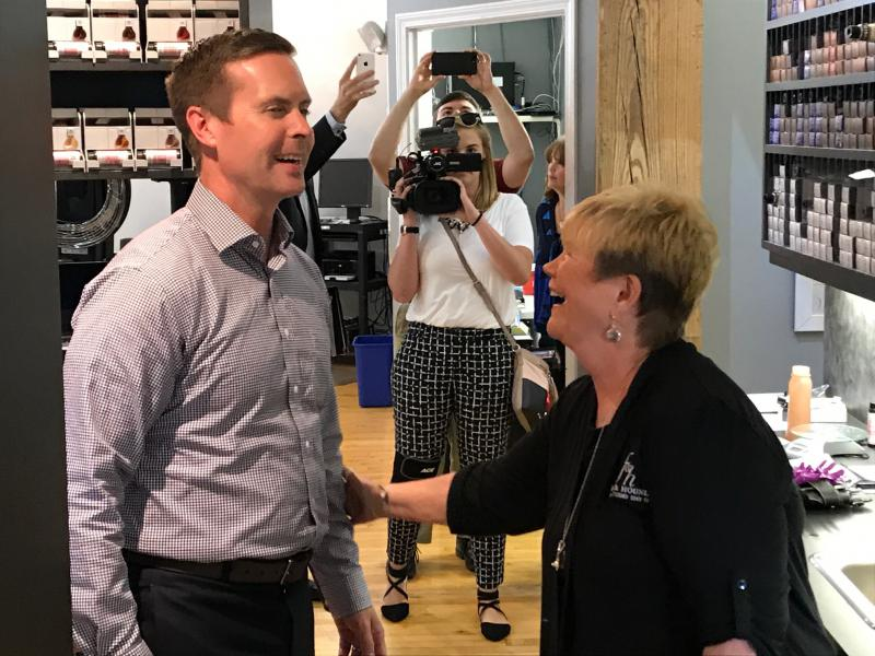 U.S. Rep. Rodney Davis, R-Taylorville, talks with owner Vicki Tilton during a tour of the small business Fox and Hounds in Bloomington.