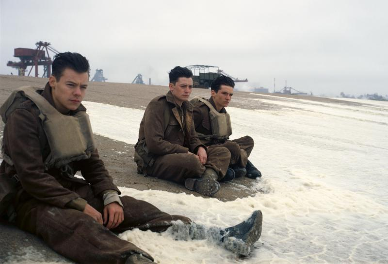 "This image released by Warner Bros. Pictures shows Harry Styles, from left, Aneurin Barnard and Fionn Whitehead in a scene from ""Dunkirk."""