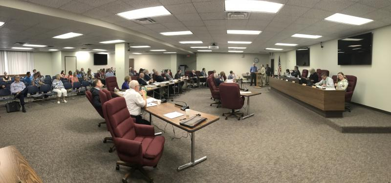 McLean County Board members passed without debate funding for the mental health coordinator position that consumed significant time last month.