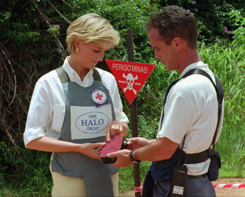 Princess Diana uses a remote switch on Jan.15, 1997, to trigger the detonation of some explosive ordinance dug up by mine sweepers in Huambo, Angola. Diana was visiting Angola in an effort to raise awareness of the problem of land mines.
